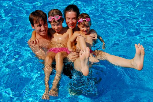 Family enjoying a clean pool in Mesquite TX