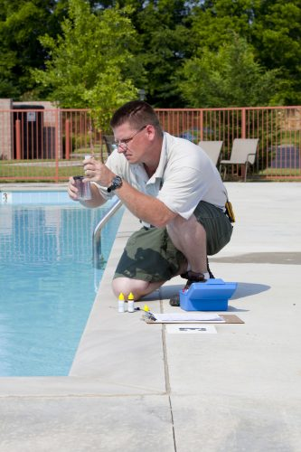 Pool service company checking chemical balance.